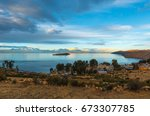 landscape of the titicaca lake... | Shutterstock . vector #673307785