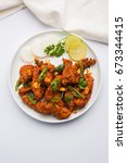 chicken 65   spicy deep fried... | Shutterstock . vector #673344415