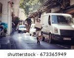messenger delivering parcel | Shutterstock . vector #673365949