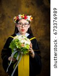 chinese girl in graduation... | Shutterstock . vector #673376989