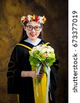 chinese girl in graduation... | Shutterstock . vector #673377019