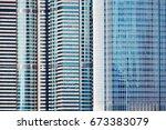 modern glass skyscrapers... | Shutterstock . vector #673383079