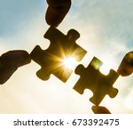 two hands trying to connect... | Shutterstock . vector #673392475