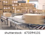 cardboard boxes on conveyor... | Shutterstock . vector #673394131