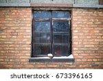 window on the brick wall in... | Shutterstock . vector #673396165