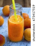 fresh apricot smoothie bottle... | Shutterstock . vector #673417519