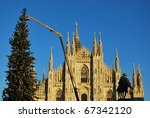 Gothic cathedral and christmas tree on blue sky, Milan, Italy - stock photo