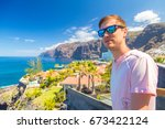young man standing by the los... | Shutterstock . vector #673422124