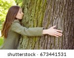 Young Woman Hugging And Kissin...