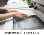 woman hands putting a sheet of... | Shutterstock . vector #673451779