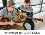 learning to play the guitar.... | Shutterstock . vector #673452301