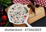 long grain rice with vegetable | Shutterstock . vector #673462825