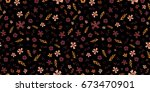 seamless ditsy floral pattern... | Shutterstock .eps vector #673470901