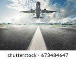 airplane landing | Shutterstock . vector #673484647