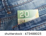 canadian dollar in a jeans... | Shutterstock . vector #673488025