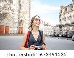 young woman tourist walking... | Shutterstock . vector #673491535