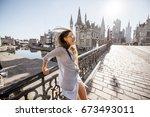 young woman tourist having fun... | Shutterstock . vector #673493011