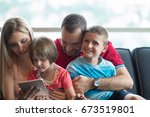 happy young family playing... | Shutterstock . vector #673519801