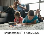 happy young family playing... | Shutterstock . vector #673520221