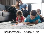 happy young family playing... | Shutterstock . vector #673527145