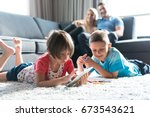 happy young family playing... | Shutterstock . vector #673543621
