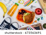 lunch box and school supplies.... | Shutterstock . vector #673563691