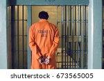 Handcuffed Prisoner In Jail
