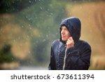 young man walking in nature...   Shutterstock . vector #673611394