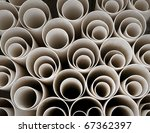 Close up of stack of plastic pipes - stock photo