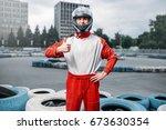 kart driver in helmet  karting... | Shutterstock . vector #673630354