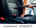 man cleans car interior with... | Shutterstock . vector #673631071