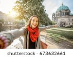 young woman tourist making... | Shutterstock . vector #673632661