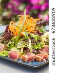 Small photo of Seared ahi tuna served with mixed greens, shredded carrots and green onions