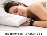 woman sleeping on bed with... | Shutterstock . vector #673634161