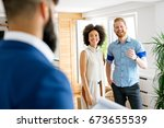 couple buying a house. | Shutterstock . vector #673655539