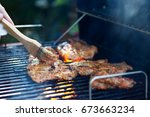 marinating meat during grilling.... | Shutterstock . vector #673663234