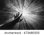 hand reaches out to touch the... | Shutterstock . vector #673680205