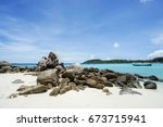stone pales on the beach at... | Shutterstock . vector #673715941