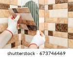 installation of ceramic tiles.... | Shutterstock . vector #673746469
