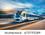 high speed train in motion at... | Shutterstock . vector #673755289