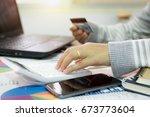 businesswoman using calculator...   Shutterstock . vector #673773604