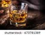 whiskey drinks on rustic oak... | Shutterstock . vector #673781389