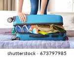 woman trying to lock heavy... | Shutterstock . vector #673797985