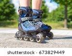 roller skating in summer. blue... | Shutterstock . vector #673829449