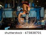 industrial robot is welding... | Shutterstock . vector #673838701