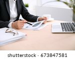 business woman sitting at the... | Shutterstock . vector #673847581