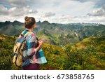 traveler with backpack enjoying ...   Shutterstock . vector #673858765