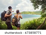 tourist couple with backpacks... | Shutterstock . vector #673858771
