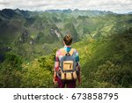 woman traveler with backpack... | Shutterstock . vector #673858795