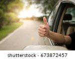 happy woman raised arms from... | Shutterstock . vector #673872457